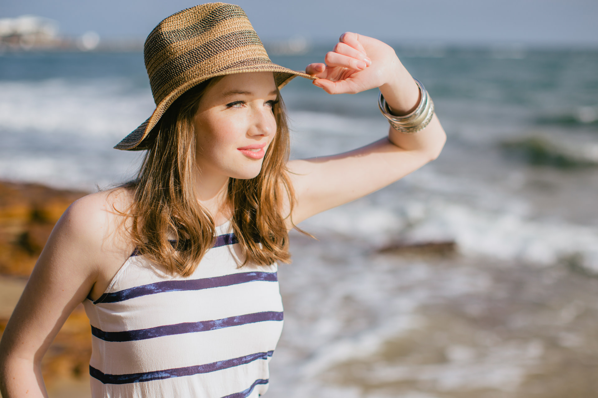 summer portrait of girl wearing sunhat