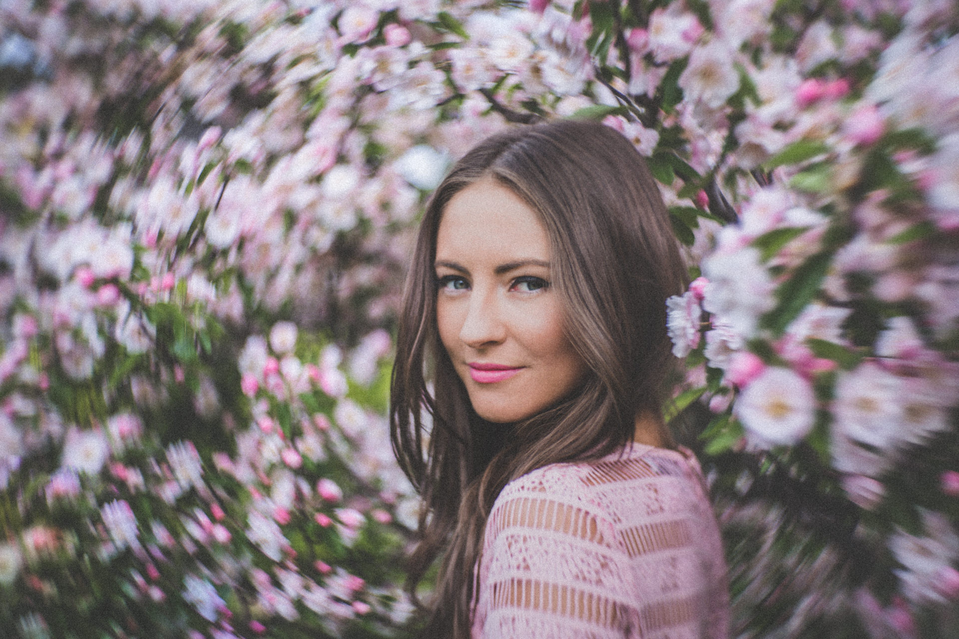 flower fashion photography - blossoms surrounding portrait by fashion photographer in melbourne