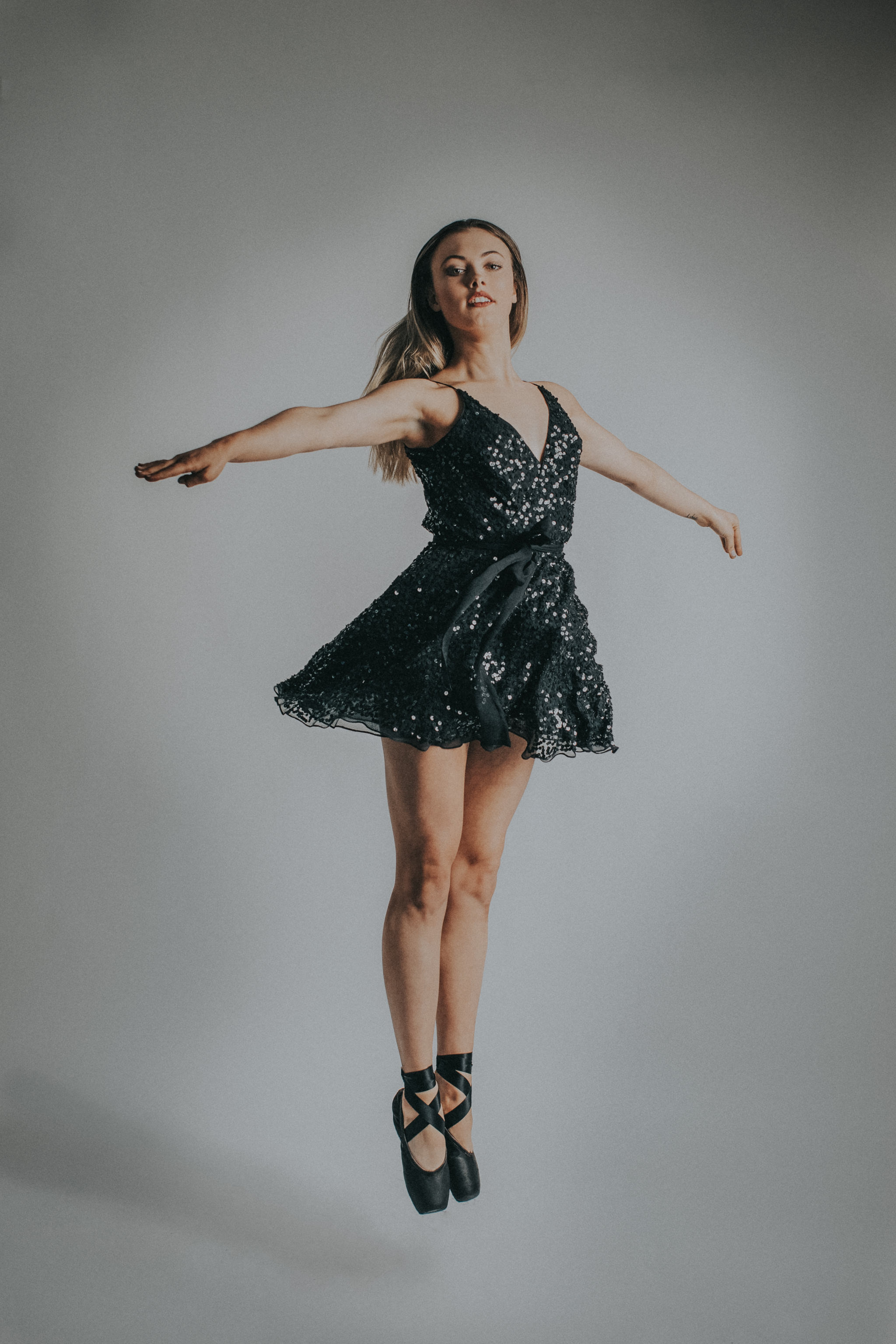 dancer jumps - black dress - ballerina outfit