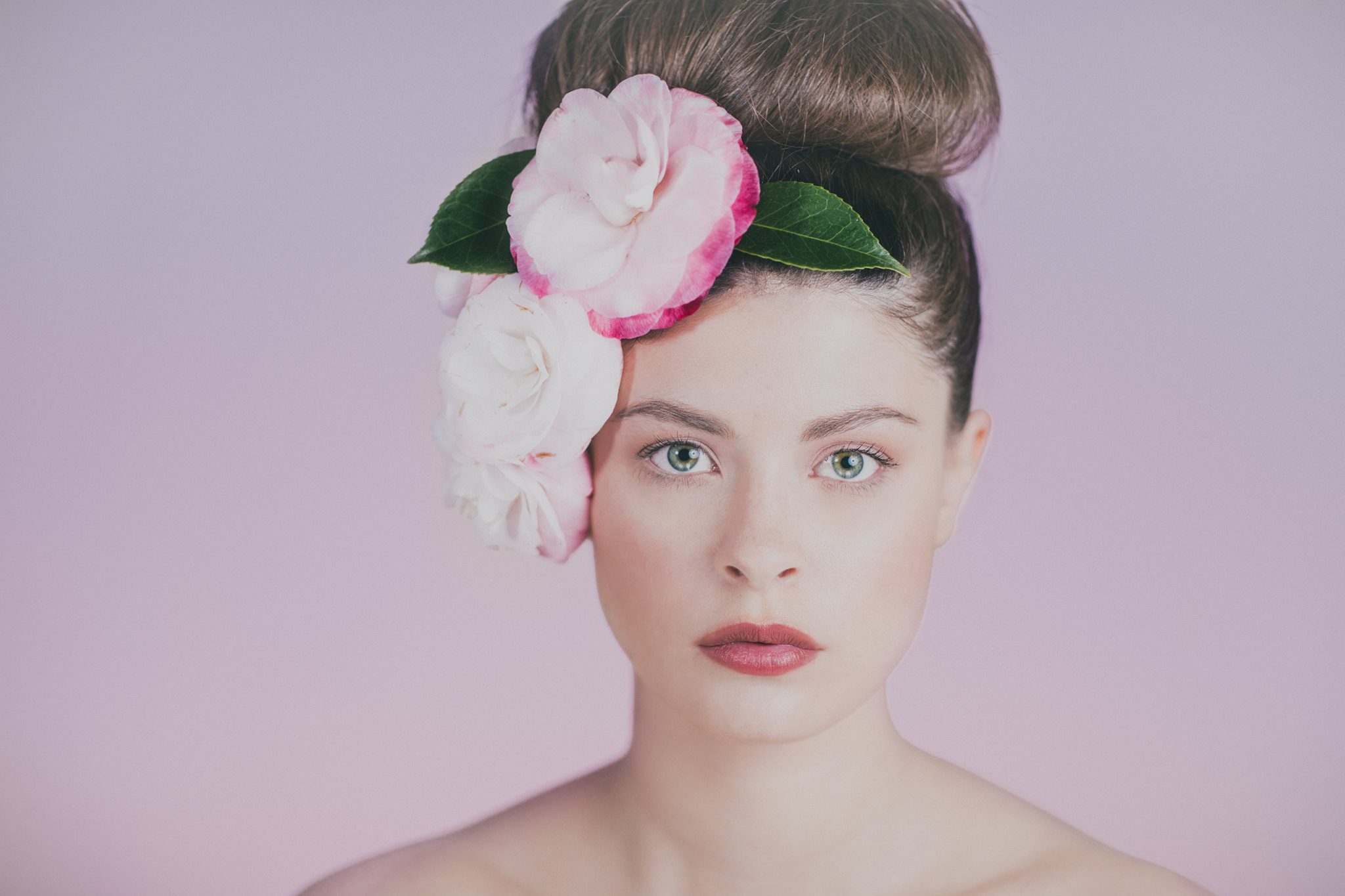 flower portrait of girl with pink background - beauty photography in australia