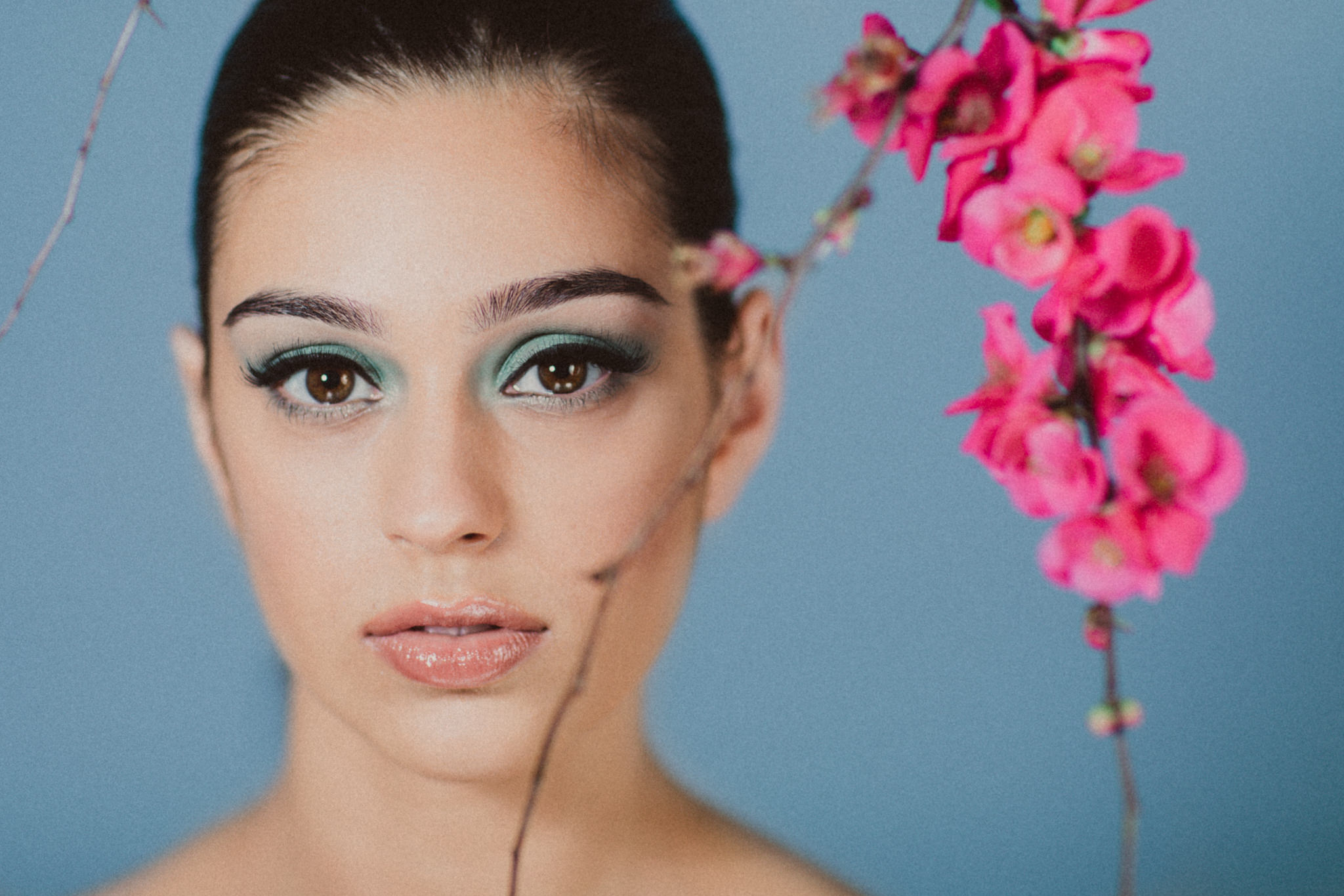 the face and flowers - beauty on blue backdrop pastels and flowers