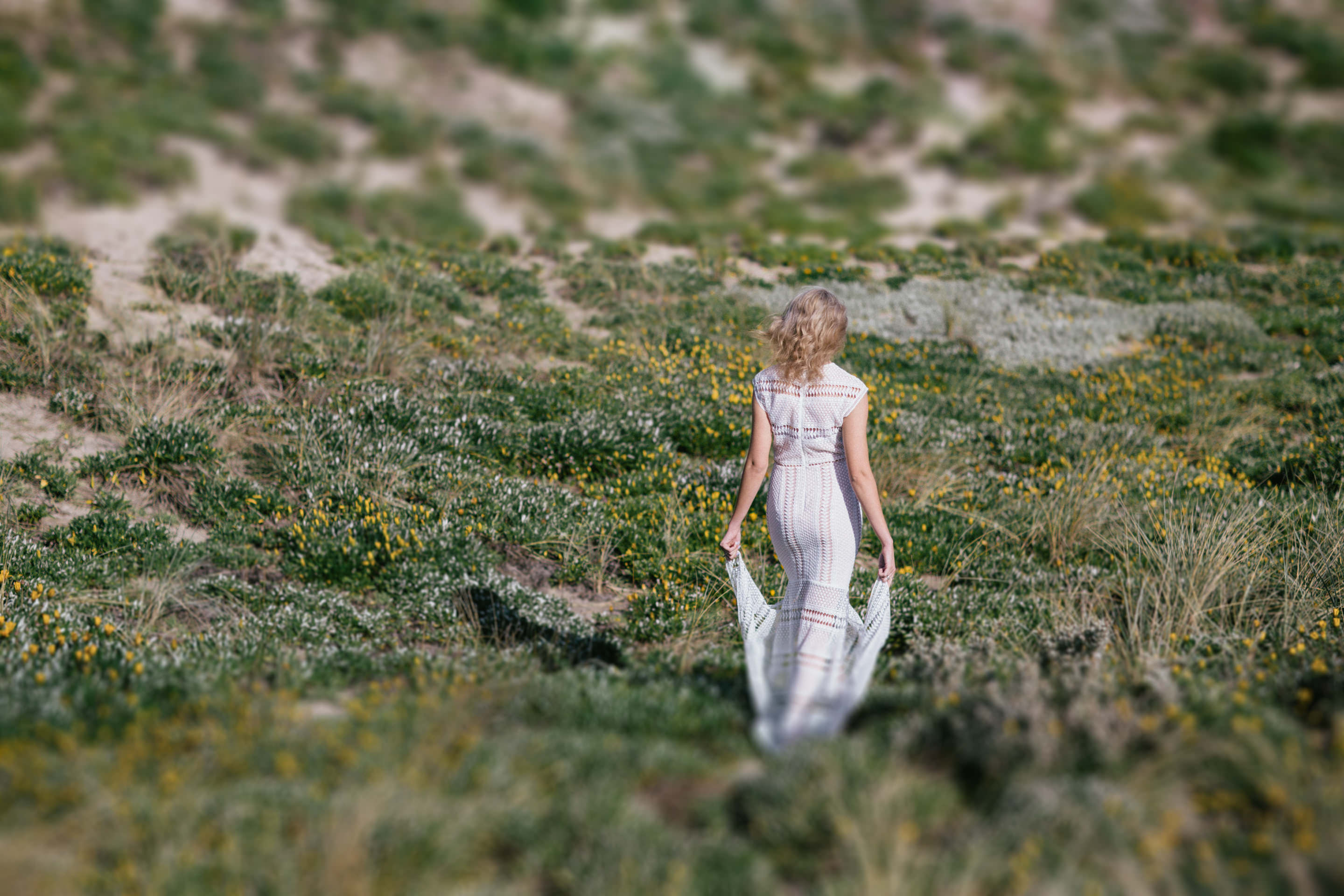 beauty walking through sand dunes