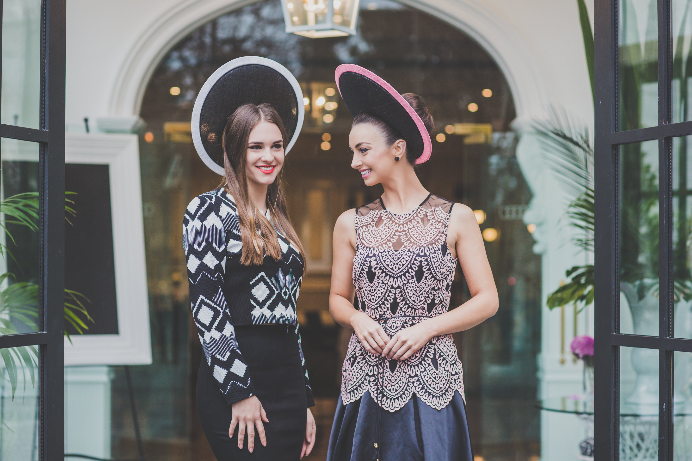 2 models with millinery at location photoshoot