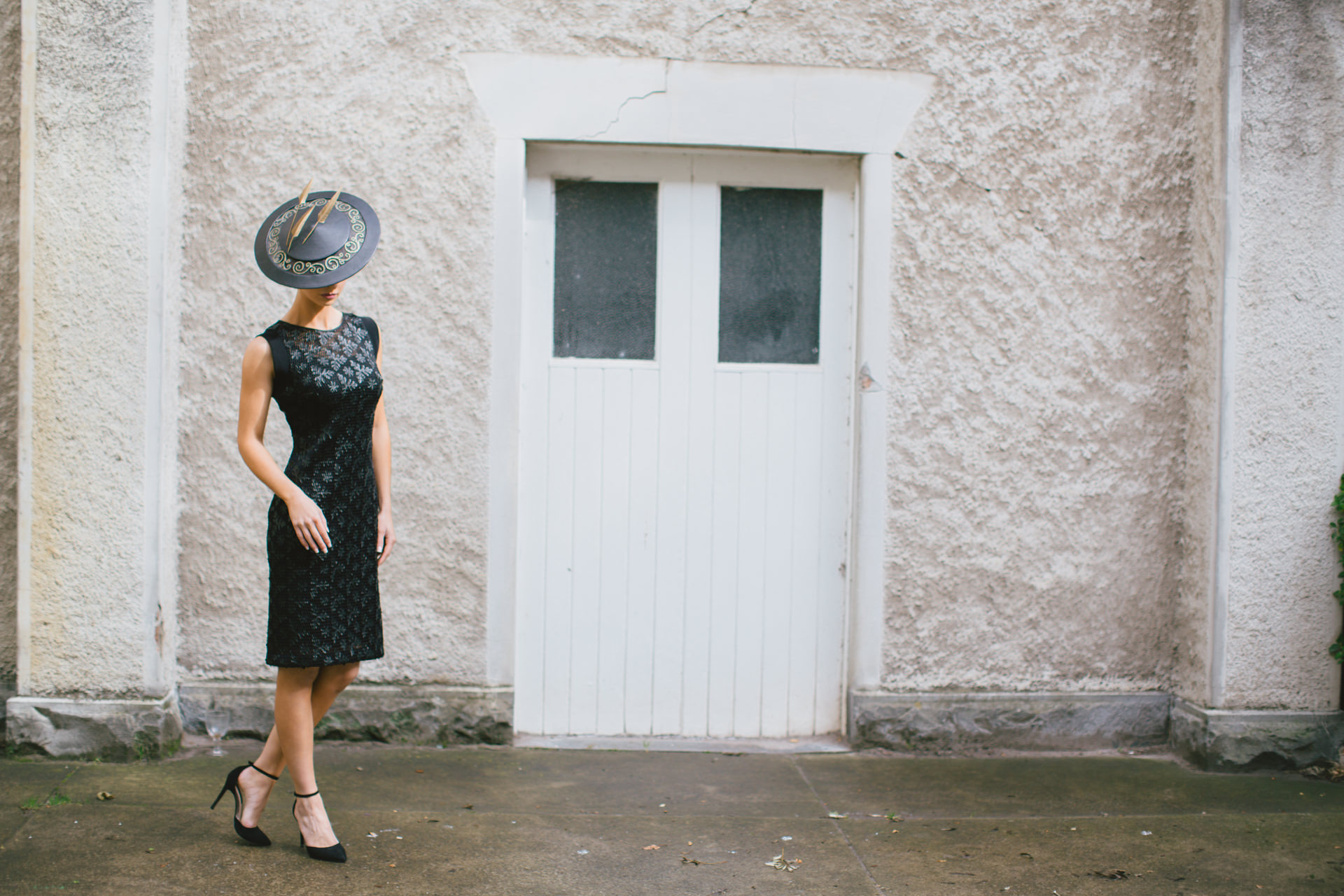 commercial fashion photographer - entry door with girl in racing fashion