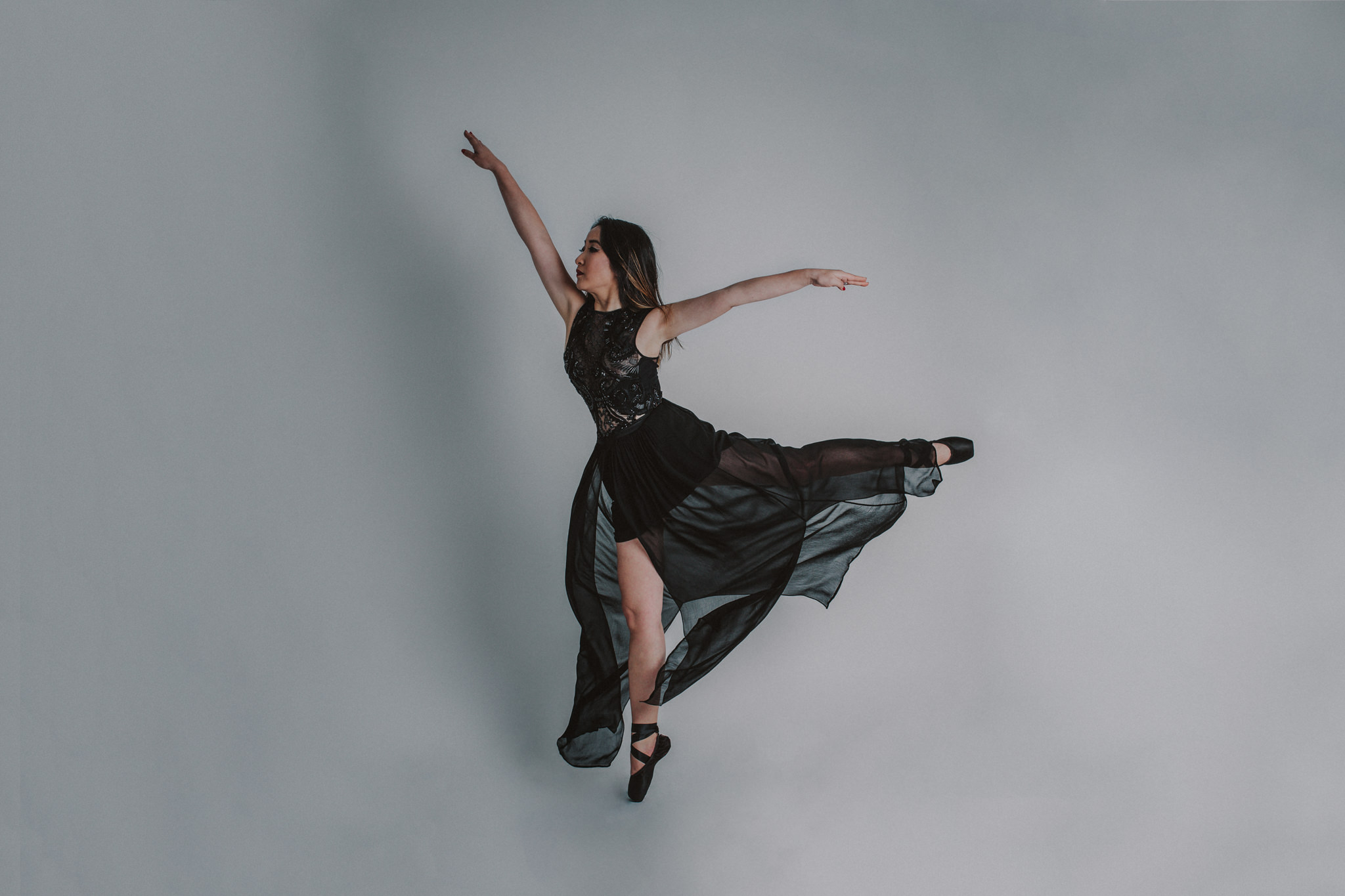 dance in photostudio - model and photographer create amazing photographs