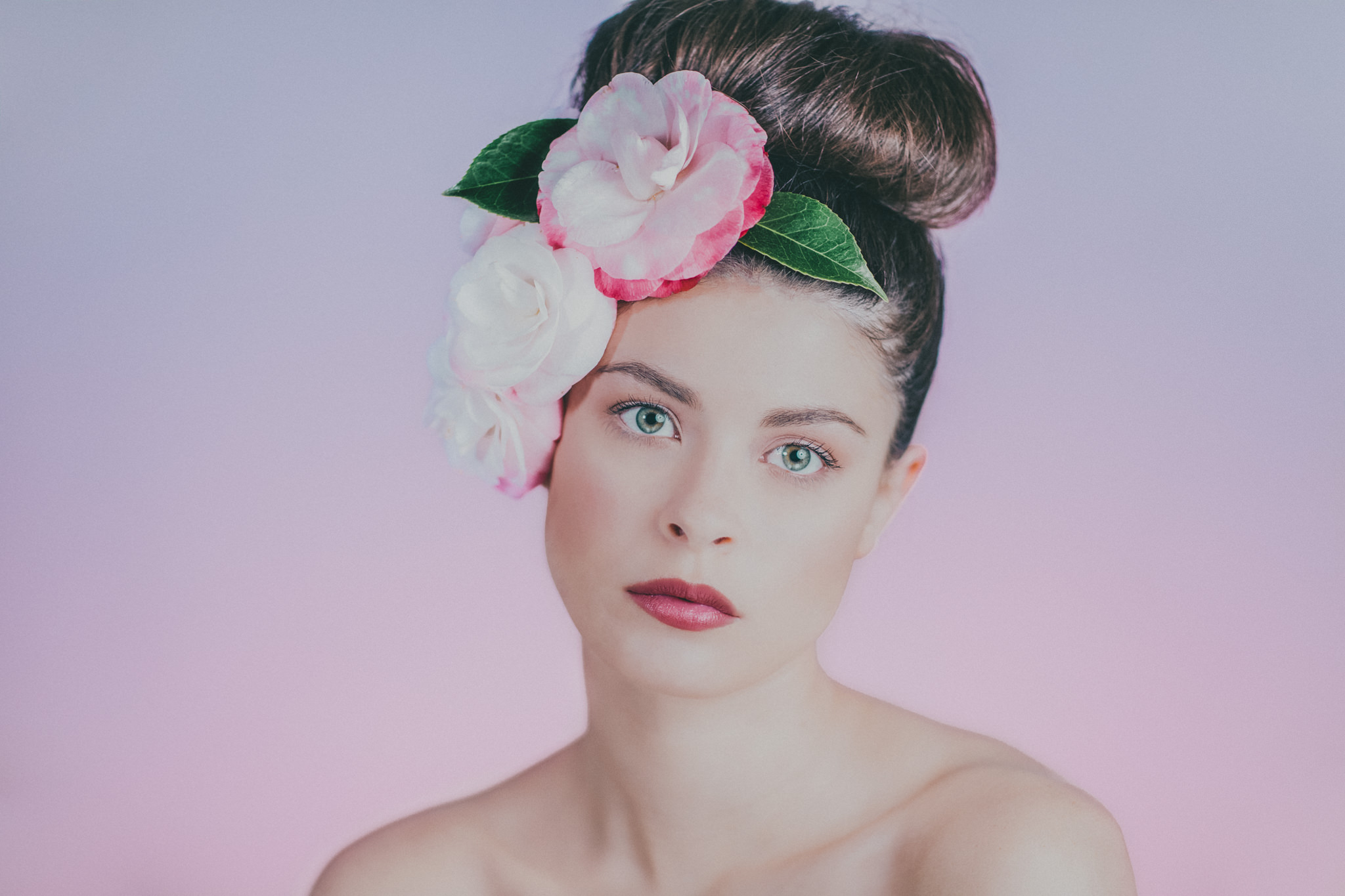 beautiful girl portrait photographed by melbourne beauty photographer - pink backdrop - pink flowers - camelias