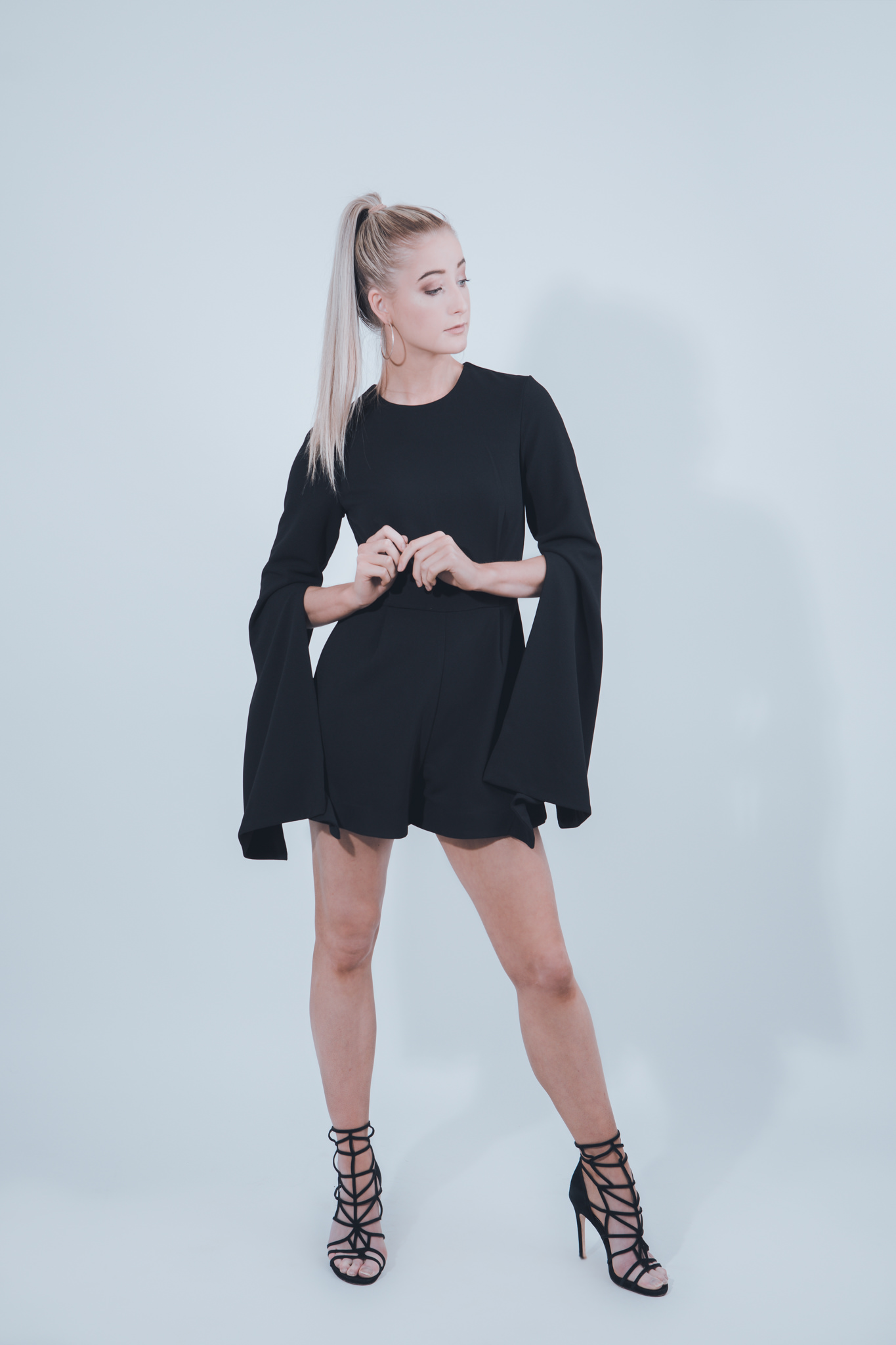 black mini dress with long sleeves on model