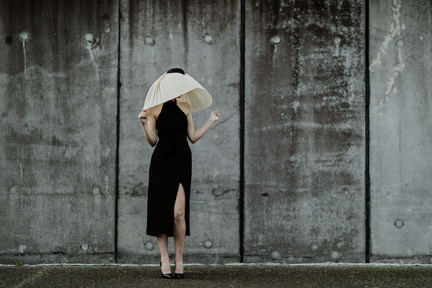 model in fashion lifestyle shoot - concrete wall with model wearing millinery _ melbouren races lifestyle photography